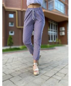 Легкі брюки великих розмірів в горошок