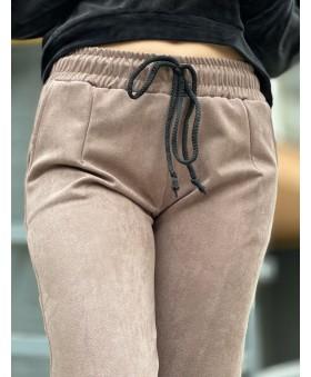 Повсякденні брюки бежевого кольору на резинці